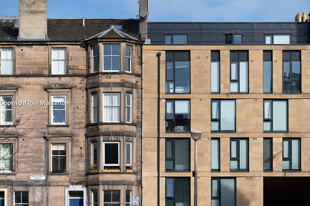 Detail of modern apartment building adjacent to old tenement building in Edinburgh, Scotland, UK