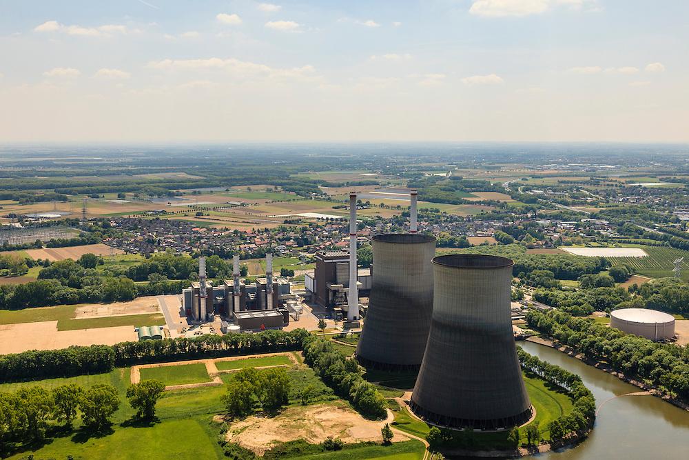 Nederland, Limburg, Gemeente Maasgouw, 27-05-2013; Maasbracht, Prins Clauscentrale, elektriciteitscentrale van Essent gelegen aan de Maas, werkt voornamelijk op aardgas. Levert ook groene stroom waarvoor de centrale gestookt wordt met plantaardige olie. De centrale wordt gekoeld met behulp van de monumentale koeltorens en/of rivierwater. De centrale is uitgebreid met een STEG-eenheid (stoom- en gasturbine). Maasplassen in de achtergrond.<br /> Prins Claus power plant (Essent) situated on the Maas, working primarily on natural gas. The plant can also supply green electricity if fueled with vegetable oil. The plant is either cooled by the monumental cooling towers and / or river water.<br /> luchtfoto (toeslag op standard tarieven);<br /> aerial photo (additional fee required);<br /> copyright foto/photo Siebe Swart