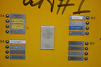 Doorbells in Amsterdam with nameplates and graffiti<br />