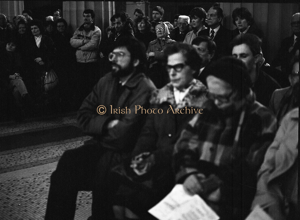 Funeral Of Sean McBride.   (R71)..1988..18.01.1988..01.18.1988..18th January 1988..Today saw the Funeral of Seán McBride.Seán MacBride was an Irish government minister, a prominent international politician and a former Chief of Staff of the IRA. His funeral took place from the Pro-Cathedral in Dublin to the family plot in Glasnevin Cemetery, Dublin.The Chief mourners were Tiernan McBride,son, Anna White,daughter and Declan White, son in law...Gerry Adams of Sinn Fein is pictured at the funeral of Sean McBride