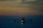 16 FEBRUARY 2003 - PUERTO PENASCO, SONORA, MEXICO: A shrimper extends his nets and trawls in the waters off of Puerto Penasco, Sonora, Mexico, Feb.16, 2003. Puerto Penasco was founded as a fishing village on the northern tip of the Sea of Cortez in 1927. New environmental regulations and over fishing have reduced the town?s reliance on fishing but increasing number of North Americans have turned the town into a tourist get away, and its proximity to Phoenix, AZ, have made it a popular destination for Arizona retirees. It is also known as Rocky Point among American tourists.   PHOTO BY JACK KURTZ