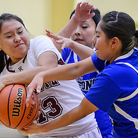 Rehoboth Lynx Kayla Cowboy (13) snatches the ball from Shiprock Northwest Falcons Naomi Begaye (10) and Meralda Barbone (5) Tuesday at Rehoboth High School.