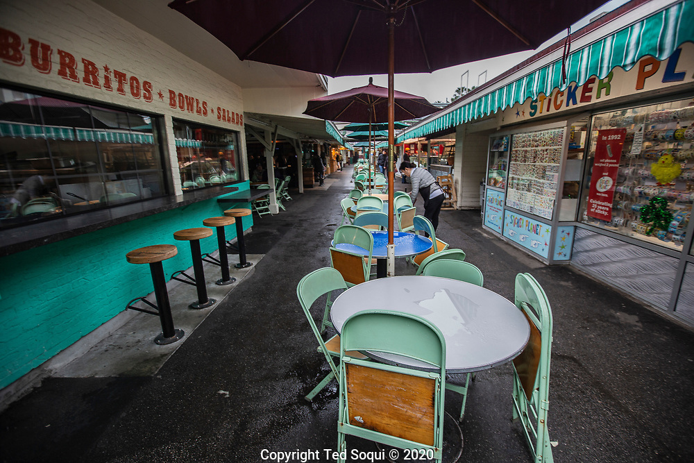 2:32pm 3/13/2020 <br /> Empty tables and chairs at L.A.'s Farmer's Market. Tourist are not visiting the popular market due to a travel ban and coronavirus fears.