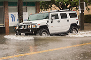 A large SUV plows through floodwater along Calhoun Street in the historic district as Hurricane Joaquin brings heavy rain, flooding and strong winds as it passes offshore October 3, 2015 in Charleston, South Carolina.
