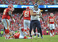 KANSAS CITY, MO - OCTOBER 20:  Defensive end J.J. Watt #99 of the Houston Texans reacts after sacking quarterback Alex Smith #11 of the Kansas City Chiefs during the second half on October 20, 2013 at Arrowhead Stadium in Kansas City, Missouri.