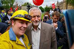 © Licensed to London News Pictures. 25/05/2016. London, UK. Leader of opposition and Labour leader JEREMY CORBYN poses for a selfie with a steel worker whilst joining hundreds of steelworkers from across the UK to march through Westminster in London to keep up pressure for government help for steel industry on Wednesday, 25 May 2016. Photo credit: Tolga Akmen/LNP
