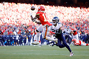Kansas City Chiefs wide receiver Tyreek Hill (10) goes up to catch a pass for a touchdown as Tennessee Titans cornerback Logan Ryan (26) defends during an NFL, AFC Championship football game Sunday, Jan. 19, 2020, in Kansas City, MO. The Chiefs won 35-24 to advance to Super Bowl 54. (AP Photo/Colin E. Braley) Colin Eric Braley Photography