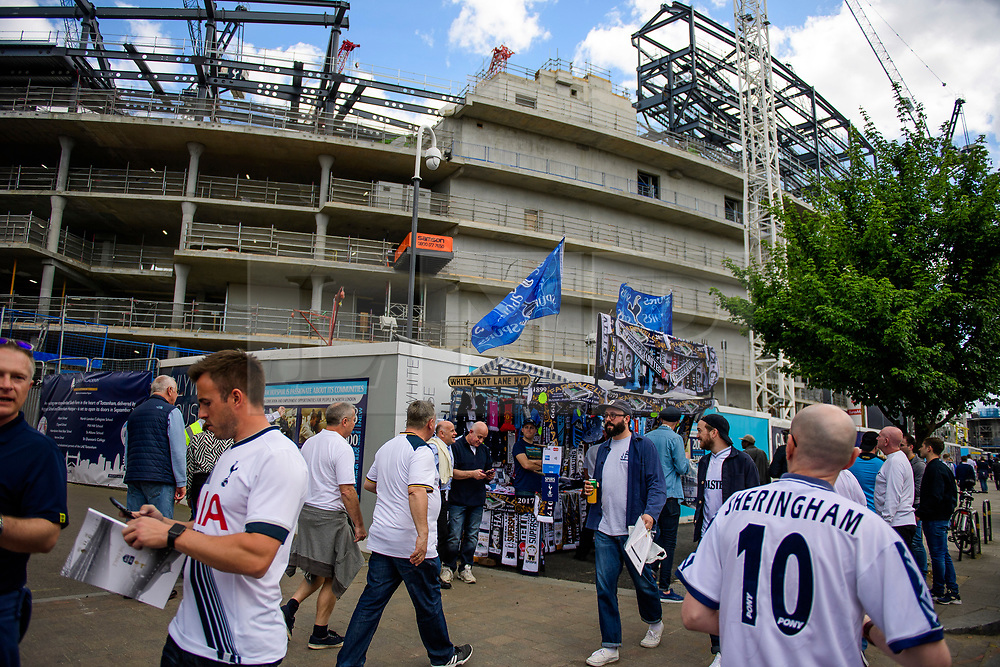 © Licensed to London News Pictures. 14/05/2017. London, UK. Fans walk past the building site for the new stand, which is being built next to  White Heart Lane, in North London where Tottenham Hotspur F.C. are playing their final game at the ground, against Manchester united today (Sun). Known as 'The Lane', Tottenham have been playing at the ground for 118 years, but will be playing at Wembley next season while a new 60,000 seat stadium is built for the start of the 2018/19 season.  Photo credit: Ben Cawthra/LNP