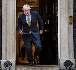 © Licensed to London News Pictures. 13/12/2019. London, UK. British Prime Minister BORIS JOHNSON is seen leaving 10 Downing Street in London to deliver a speech to media, on the day the Conservative party achieved a clear majority in the General Election. A general election was called for December 12th following a deadlock in Parliament over the UK's decision to leave the EU. Photo credit: Ben Cawthra/LNP