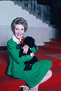"""Washington, DC.  1984/12/10    First Lady Nancy Reagan during a taping of a """"Christmas in the White House"""" special. She is playing with the Reagan's new puppy """"Lucky""""  Sitting next to her is one of the White House electrician who is actually the person who watches after all of the presidential pets.<br /><br />Photograph by Dennis Brack"""