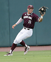 Texas A&M's J.B. Moss (11) fields a ground ball against TCU during the 1st inning of a NCAA college baseball super regional tournament game, Friday, June 10, 2016, in College Station, Texas. (AP Photo/Sam Craft)