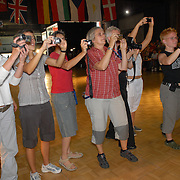 Fellow dancers and spectators photograph the winners of the women's standard C division on the medal stand at the same-sex ballroom dancing competition during the 2007 Eurogames at the Waagnatie hangar in Antwerp, Belgium on July 14, 2007. ..Over 3,000 LGBT athletes competed in 11 sports, including same-sex dance, during the 11th annual European gay sporting event. Same-sex ballroom is a growing sports that has been happening in Europe for over two decades.