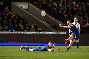 Sale Sharks centre Sam James holds the ball in the wind as stand-off Rob Du Preez kicks a penalty during a Gallagher Premiership Rugby Union match, Sale Sharks -V- Leicester Tigers, Friday, Feb. 21, 2020, in Eccles, United Kingdom. (Steve Flynn/Image of Sport via AP)