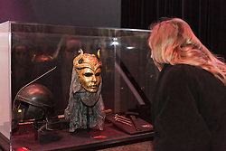 © Licensed to London News Pictures. 09/02/2015. London, UK. A woman looks at exhibits  at the Game of Thrones Exhibition on 9th February 2014 at the O2 Arena in Greenwich, south-east London. Photo credit : Vickie Flores/LNP