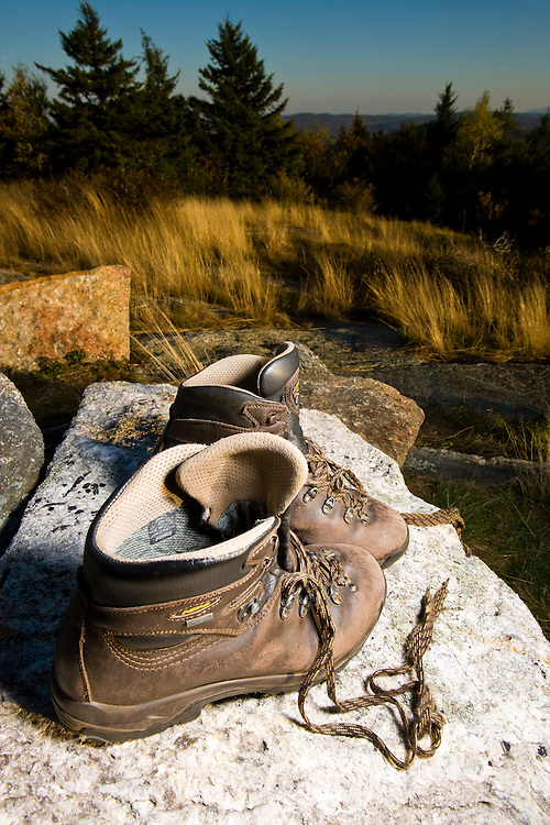 Hiking boots on the summit of Silver Mountain in Lempster, New Hampshire.