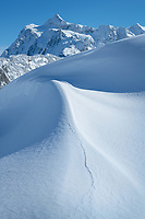 Kulshan Ridge snowdrift, Mount Shuksan is in the distance. Heather Meadows Recreation Area, North Cascades Washington