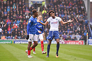 Wycombe Wanderers Defender, Sido Jombati (2) protests with Portsmouth Midfielder, Jamal Lowe (10) during the EFL Sky Bet League 1 match between Portsmouth and Wycombe Wanderers at Fratton Park, Portsmouth, England on 22 September 2018.