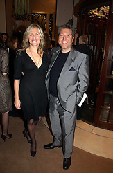 DJ NEIL FOX and his wife VICTORIA at a Christmas party to celebrate the 225th Anniversary of Asprey held at their store 167 New Bond Street, London on 7th December 2006.<br /><br />NON EXCLUSIVE - WORLD RIGHTS