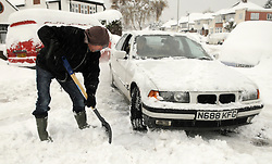 © under license to London News Pictures.2.12.2010  A man digs out his car today (Thurs) Snow in Orpington. Picture credit should read Grant Falvey/London News Pictures