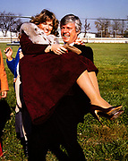 Phyllis George is playfully carried across a muddy ditch by husband and Kentucky gubernatorial candidate John Y Brown . Phyllis Ann George was an American businesswoman, actress, and sportscaster. She was also Miss Texas 1970, Miss America 1971, and the First Lady of Kentucky from 1979 to 1983. Ms. George died, aged 70, of complications from Polycythemia vera on May 14, 2020 in Lexington, Kentucky.