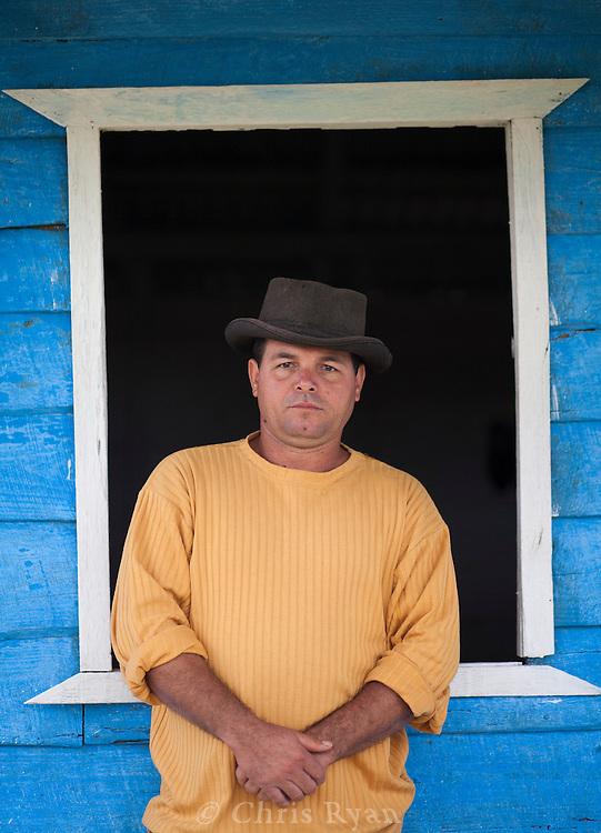 Portrait of farmer in front of farmhouse, Vinales Valley, Cuba