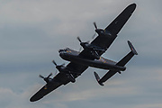 The Battle of Britain Memorial Flight, including an Avro Lancaster B1 (pictured), a Supermarine Spitfire and a Hawker Hurricane - Duxford Battle of Britain Air Show taking place during IWM (Imperial War Museum) Duxford's centenary year. Duxford's principle role as a Second World War fighter station is celebrated at the Battle of Britain Air Show by more than 40 historic aircraft taking to the skies.