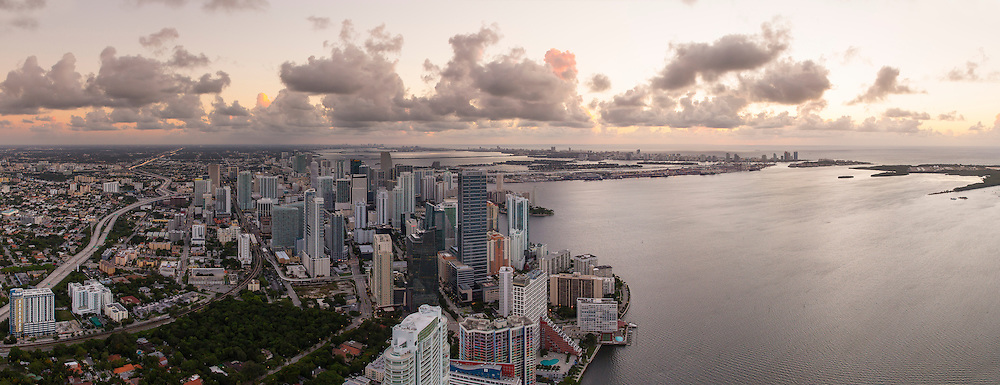 Aerial view of downtown Miami and Brickell Avenue at twilight.