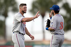 July 7, 2017 - Jupiter, Florida, U.S. - St. Lucie Mets Tim Tebow high fives a teammate in the second inning at Roger Dean Stadium in Jupiter, Florida on July 7, 2017. (Credit Image: © Allen Eyestone/The Palm Beach Post via ZUMA Wire)