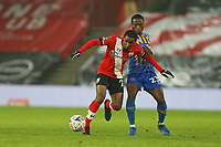 Football - 2020 / 2021 Emirates FA Cup - Round Three - Southampton vs. Shrewsbury Town - St Mary's Stadium<br /> <br /> Southampton's Ibrahima Diallo and Daniel Udoh of Shrewsbury Town in action during the FA Cup tie at St Mary's Stadium Southampton <br /> <br /> COLORSPORT/SHAUN BOGGUST