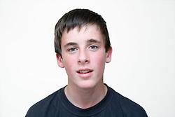 Teenaged boy smiling,