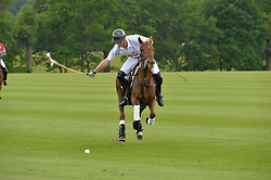 PRINCE HARRY (number 1) playing polo at the Audi Polo Challenge at Coworth Park, Blacknest Road, Ascot, Berkshire on 31st May 2015.