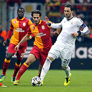 Galatasaray's Hamit Altintop (C) and Real Madrid's Gonzalo Higuain (L) during their UEFA Champions League Quarter-finals, Second leg match Galatasaray between Real Madrid at the TT Arena AliSamiYen Spor Kompleksi in Istanbul, Turkey on Tuesday 09 April 2013. Photo by Aykut AKICI/TURKPIX