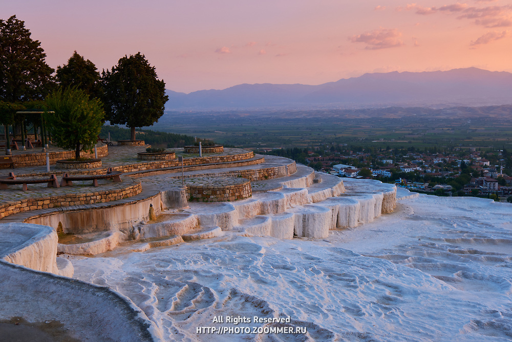 White travertine basins at sunset in Pamukkale, Turkey