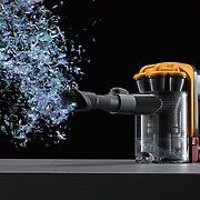product,cleaning,appliance,vacuum,handheld,Dyson,motor,suction,action,frozen,high speed,orange