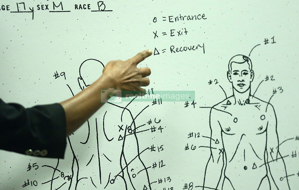 September 19, 2018 - Chicago, Illinois, U.S. - Cook County Medical Examiner Dr. Ponni Arunkumar describes details of a diagram of bullet entry and exit wounds found on the body of Laquan McDonald, as it is shown to the jury during the trial for the shooting death of McDonald by Chicago police Officer Jason Van Dyke, at the Leighton Criminal Court Building. (Credit Image: © John J. Kim/Chicago Tribune/TNS via ZUMA Wire)