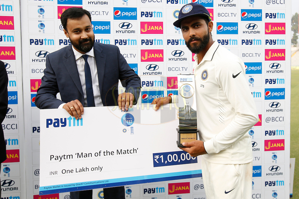 Ravindra Jadeja of India receives the Paytm Man of the Match award during day 4 of the third test match between India and England held at the Punjab Cricket Association IS Bindra Stadium, Mohali on the 29th November 2016.<br /> <br /> Photo by: Deepak Malik/ BCCI/ SPORTZPICS
