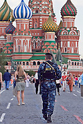 Moscow, Russia, 14/06/2006.&#xA;A uniformed Russian Interior Ministry officer armed with an automatic rifle and handgun shadows a group of foreign businessmen on Red Square as private security. The officer was detained by plain  clothes Kremlin guards moments later.<br />