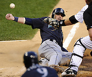 CHICAGO - JUNE 07:  Adam Kennedy #4 of the Seattle Mariners scores as the ball gets away from A.J. Pierzynski #12 of the Chicago White Sox in the fourth inning on June 7, 2011 at U.S. Cellular Field in Chicago, Illinois.  The White Sox defeated the Mariners 5-1.  (Photo by Ron Vesely)  Subject:  Adam Kennedy;A.J. Pierzynski