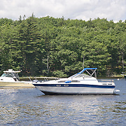 Boats in the Union River on their moorings st high tide. Ellsworth, Maine