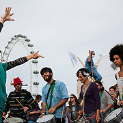 A samba band performing on Westminster Bridge..The Health and Care Bill has been passed by Parliament and is due to go to the House of Lords. In protest against the bill which aim to deconstruct and privatise large parts of the NHS UK Uncut activists together with health workers and trade unionists blocked the Westminster Bridge from 1pm til 5.30pm.