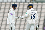 James Vince of Hampshire and Aiden Markram of Hampshire touch gloves during the first day of the Specsavers County Champ Div 1 match between Hampshire County Cricket Club and Essex County Cricket Club at the Ageas Bowl, Southampton, United Kingdom on 5 April 2019.