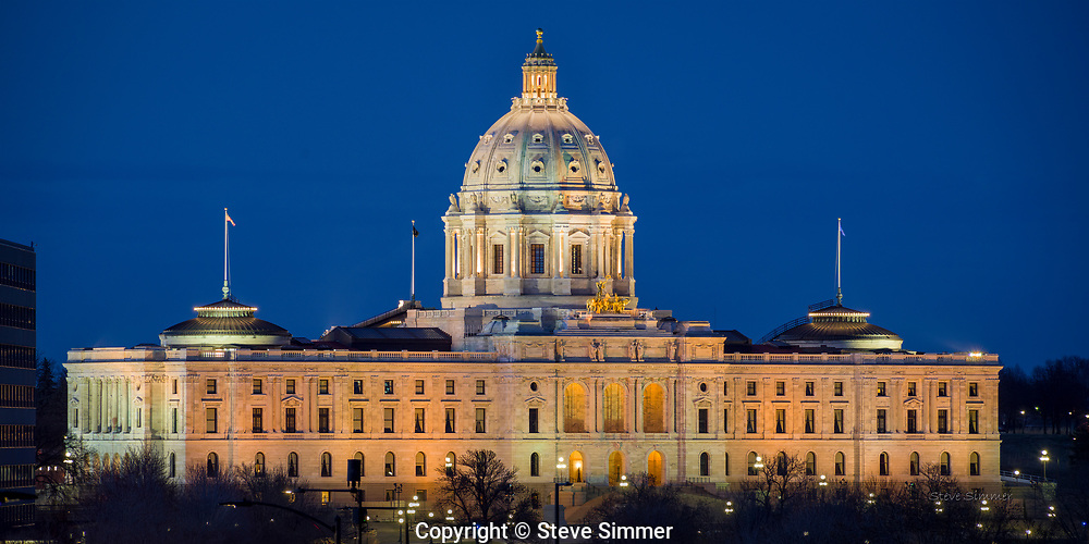 Minnesota's State Capitol building, designed by archictect Cass Gilbert, is one of the Nation's finest. This view, from the front stairway of nearby St. Paul's Cathedral, is a classic view.
