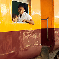 Curious boy with his mother and Yangon train station