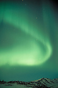 Alaska. Anchorage. Chugach Mts. Aurora borealis (northern lights).