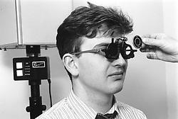 Man taking eye test at opticians,