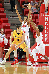 05 November 2016:   Joseph Tagarelli looks for a way past Phil Fayne(10) and Keyshawn Evans(3) during an NCAA  mens basketball game where the Quincy Hawks lost to the Illinois State Redbirds in an exhibition game at Redbird Arena, Normal IL