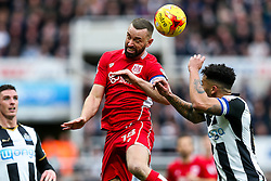 Aaron Wilbraham of Bristol City and Jamaal Lascelles of Newcastle United compete for the ball - Rogan Thomson/JMP - 25/02/2017 - FOOTBALL - St James' Park - Newcastle, England - Newcastle United v Bristol City - Sky Bet EFL Championship.