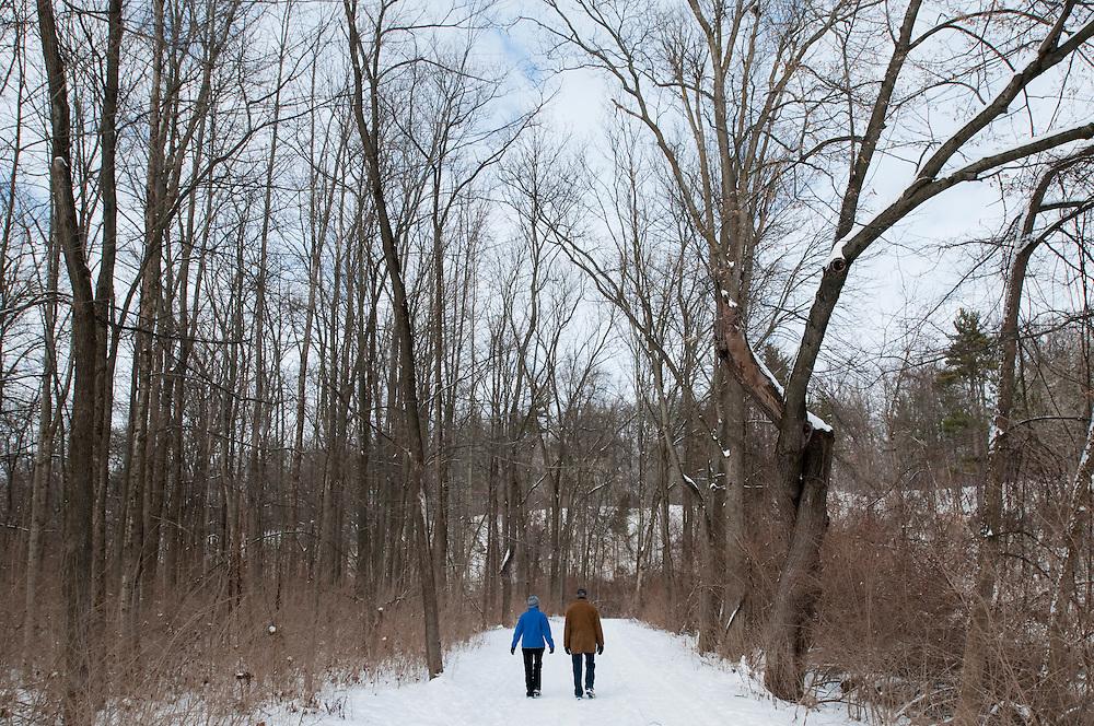 Matt Dixon   The Flint Journal..A couple walks along the River View Trail in Flushing, Friday, Jan. 28.