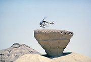 Bell 206 JetRanger helicopter landing on rock outcrop Arabian desert, Saudi Arabia oil industry 1979