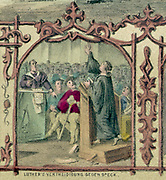 Martin Luther (1483-1546) German Protestant reformer before the Diet of Worms, 18 April 1521, confirming he was the author of the books laid out before the Diet . He was declared outlaw and a heretic. Coloured lithograph.